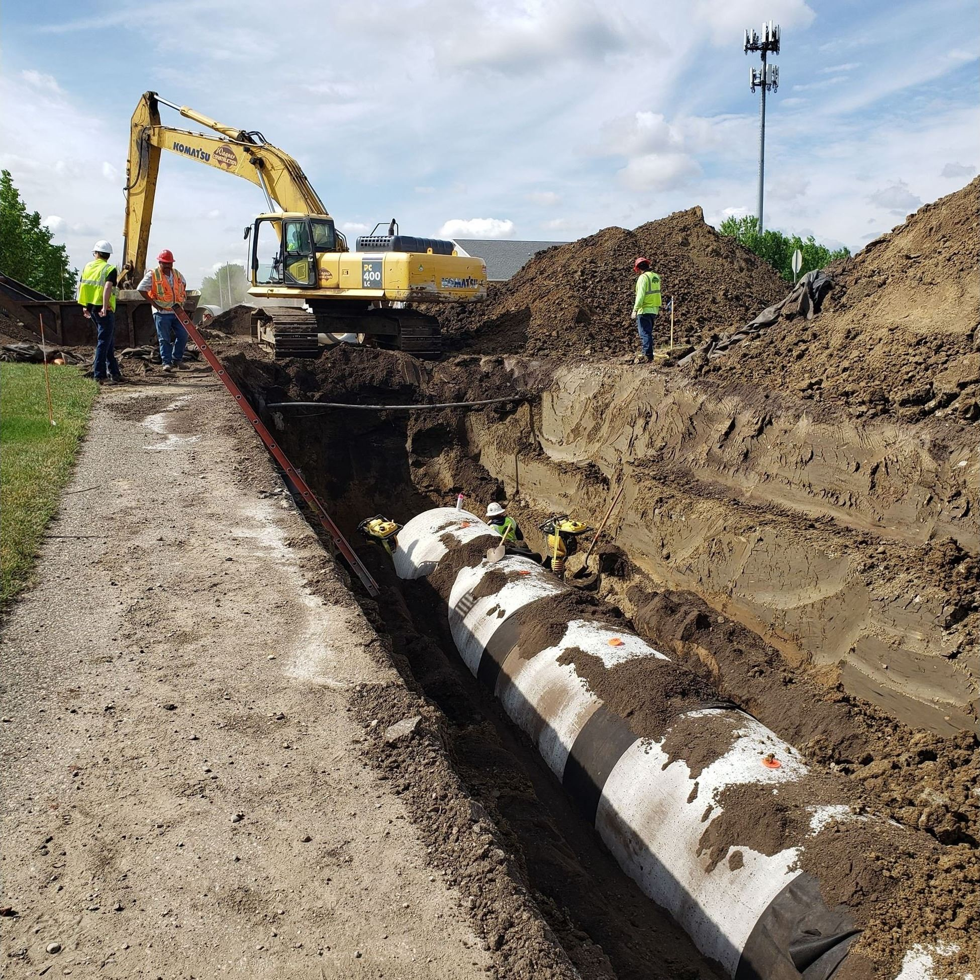 Installing large storm sewer pipe