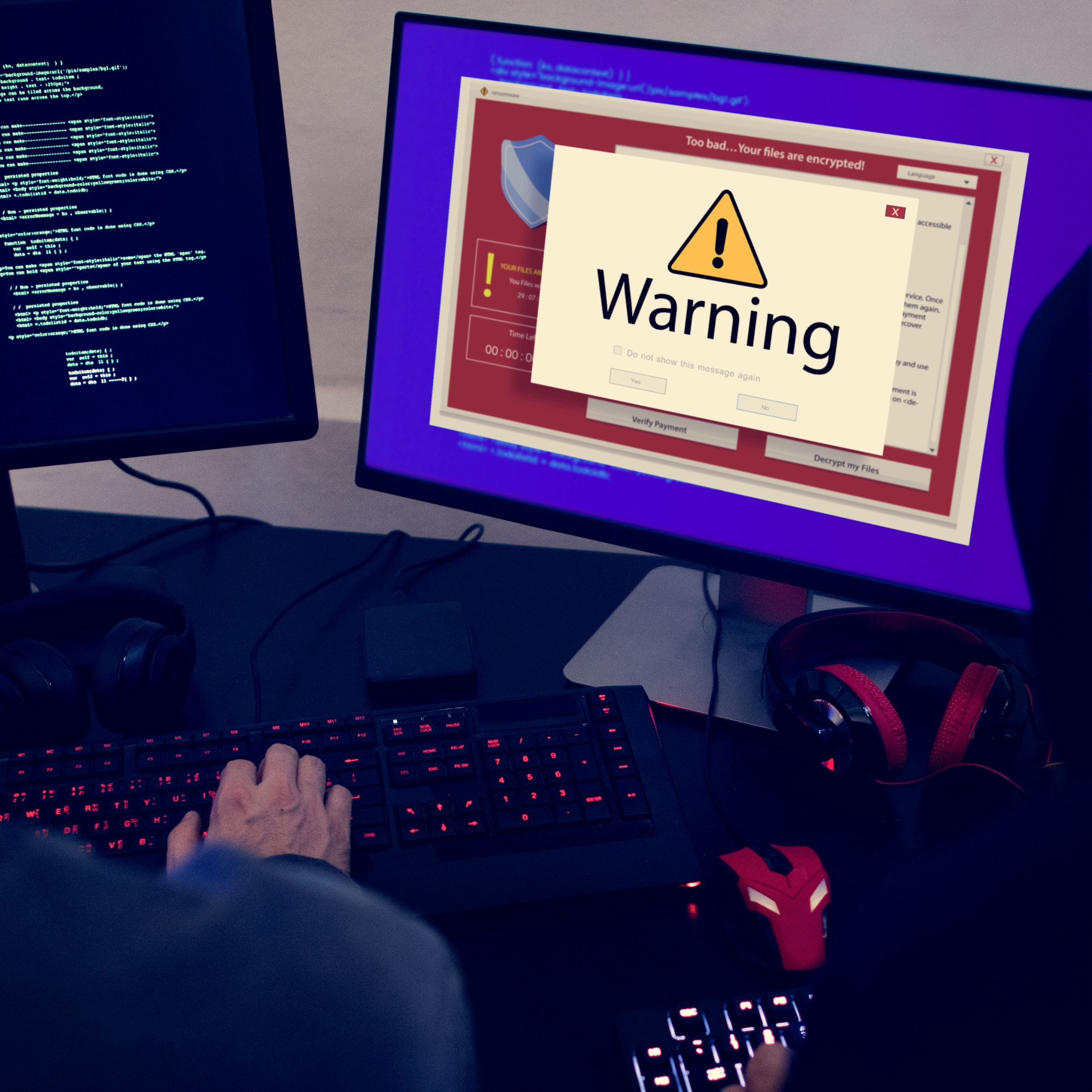computer-with-warning-pop-up-sign-window-PEA6LF5